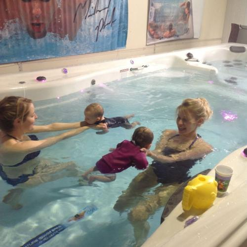 Family in a swim spa