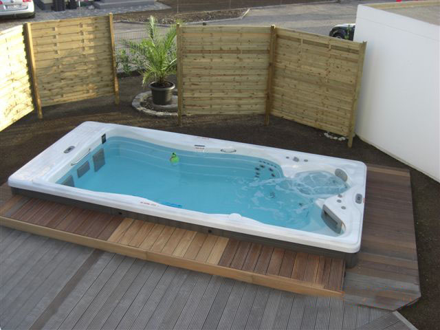 Hot tub inset in a garden with decking